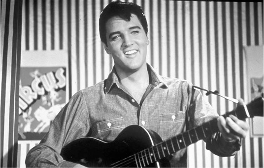 Elvis Presley reigned as the King of Rock and Roll for baby boomers in their teens, generating a mania among his female fans and influencing the Beatles and other rock artists of the 1960s.