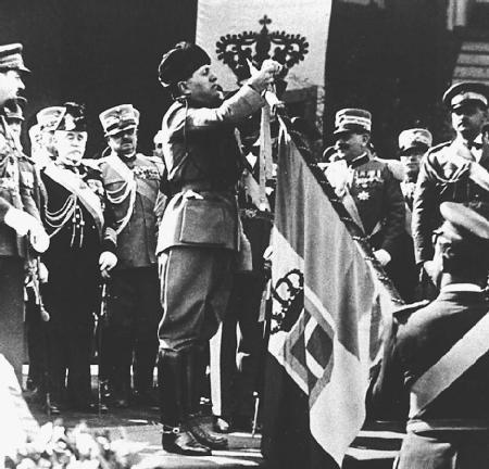 Benito Mussolini decorates the battle flag of the Royal Air Corps. (The Library of Congress)