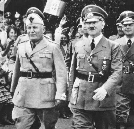 Benito Mussolini (left) and Adolf Hitler marching side by side, 1939. (Archive Photos, Inc.)