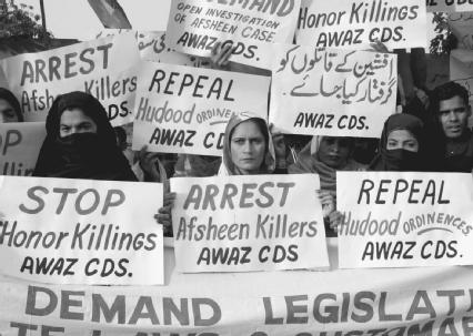 Pakistani women holding a protest rally to condemn a 2003 honor killing. Honor killings are murders by husbands or male relatives of women suspected of disobedience.