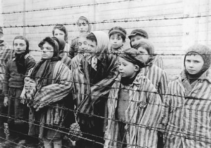 A group of Jewish children being held at the Auschwitz concentration camp in Poland.