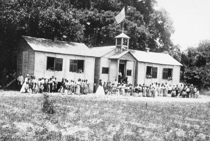 Students and teachers at a Freedmens Bureau school in Beaufort, South Carolina.  Corbis.