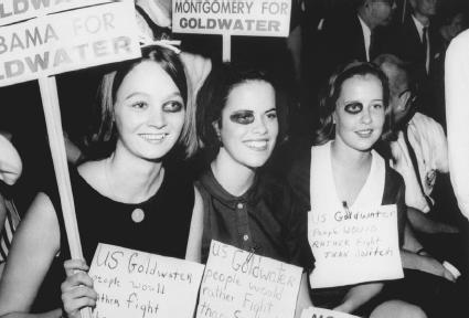 Supporters of Barry Goldwater don signs and black-eye makeup proclaiming Goldwater people would rather fight than switch [candidates], in support of the Republican presidential nominee, in Montgomery, Alabama, September 1964.  Bettmann/Corbis.