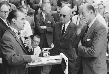 Alabama governor George Wallace (left) talks to U.S. deputy attorney general Nicholas Katzenbach (right) and U.S. Marshal Peyton Norville (middle) as he tries to prevent the integration of the University of Alabama at Tuscaloosa in June of 1963