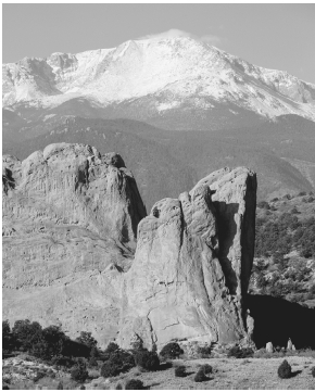 Pikes Peak rises in the background. The Colorado mountain peak was discovered in 1806 by explorer Zebulon Pike and was later named after him. ( David MuenchCorbis.)
