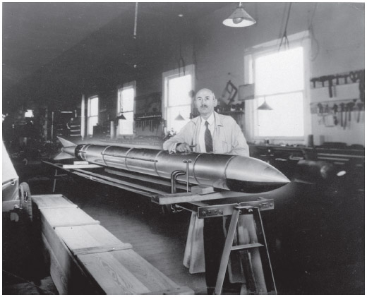 Robert Goddard, one of Americas first rocket scientists, poses with one of his rockets at Roswell, New Mexico in 1938.