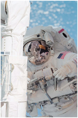 Mission specialist Linda M. Godwin works during a four-hour, 12-minute session of extravehicular activity (EVA).
