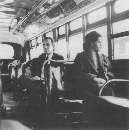 Civil Rights icon Rosa Parks sits at the front of a Montgomery, Alabama, city bus in the aftermath of the Supreme Court ruling banning segregation on public transit vehicles.