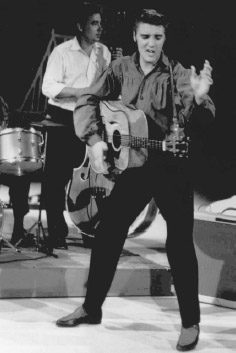 Rock and roll pioneer Elvis Presley performing on the Ed Sullivan Show on September 9, 1956