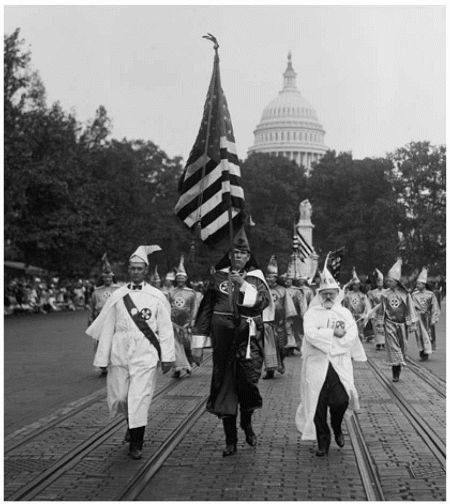 The white supremacist Ku Klux Klan—seen here marching in 1926—terrorized African Americans across the South for a full century after the end of the Civil War.