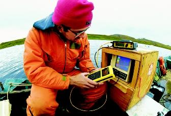Hydrologists study the physical, chemical, and biological properties of fresh water. This hydrologist tests Alaska's Toolik Lake for contamination.
