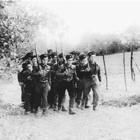 A group of Maquis, French resistance fighters, training in the forest. (Reproduced by permission of AP/Wide World Photos)