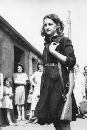 This young woman, a member of the French resistance, welcomes British troops liberating a town. (Reproduced by permission of AP/Wide World Photos)