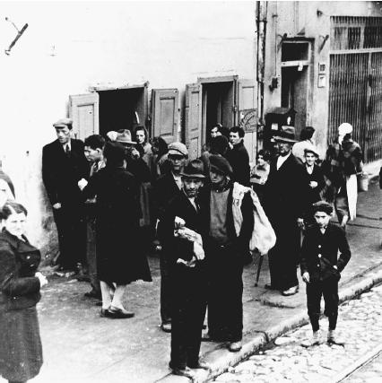 Beginning in late 1939, the Germans forced Polish Jews to move to certain areas of the city, always the poorest sections of towns, called ghettos. Many people died because of the poor living conditions. (Reproduced by permission of Art Resource)