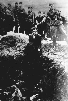 A member of Einsatzgruppe D prepares prepares to shoot a Ukrainian Jew. (Reproduced by permission of the United States Holocaust Memorial Museum)