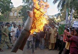 Effigy of Danish Prime Minister Burned to Protest Cartoons of Islamic Prophet Muhammad