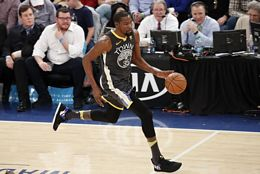 Golden State Warriors Kevin Durant Dribbles The Basketball