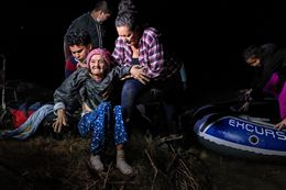 Asylum Seekers Emerge from Darkness on the Rio Grande, in Roma, Texas