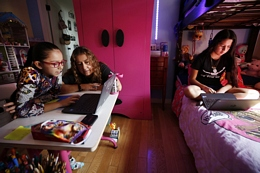 Mom Assists Daughters with Online Learning During the Pandemic