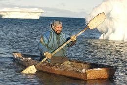 Inuit Hunter Paddling a Kyak