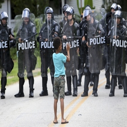 A Boy Waves at Police on Duty for Protests Near the Confederate Monument at Stone Mountain, Georgia