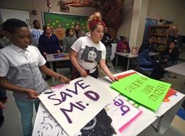 Students Make Signs in Support of Lead Teacher Freddie DeJesus