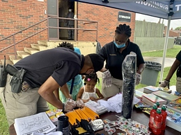 Children Interact with Birmingham Police Department's Community Outreach and Public Education ...