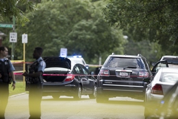 Chicago Police Officers Investigate the Scene of a Shooting