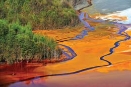 Water pollution from a copper mine. Industrial and agricultural emissions of chemicals into...