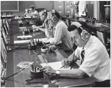 Members of the U.S. House of Representatives listen to the Watergate tapes on August 6, 1974.